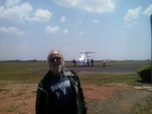 KDM's Glenn Roseberry, boarding a small aircraft for inter-Kenya travel